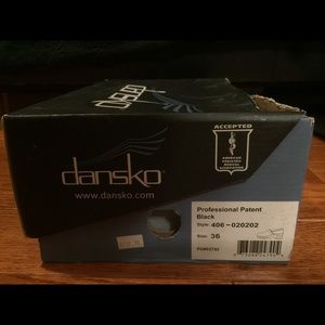 Dansko Professional Patent Black leather shoes.